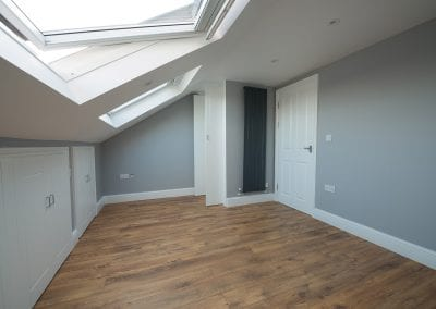 L shaped dormer into two bedrooms, build in storage and a bathroom at Plaistow, London