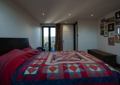 L shaped dormer into one bedroom dressing room and bathroom at Stratford London E15