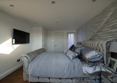 L Shaped dormer into one bedroom, dressing room and a bathroom at Leytonstone – London E11