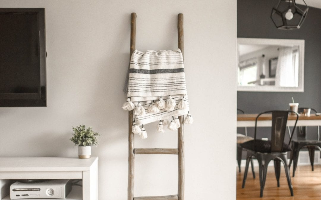 gray-wooden-ladder-on-white-painted-wall. Hard flooring cleaning tips and guide for home. Luxenta Cleaning Blog